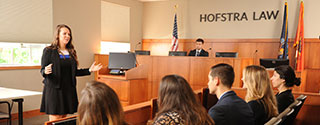 Photo of Students Working Together in the Moot Courtroom